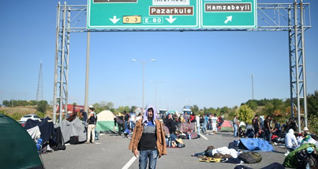 A man walks after Turkish police forces blocked migrants and refugees on a highway near Edirn during their march to the border between Turkey and Greece.