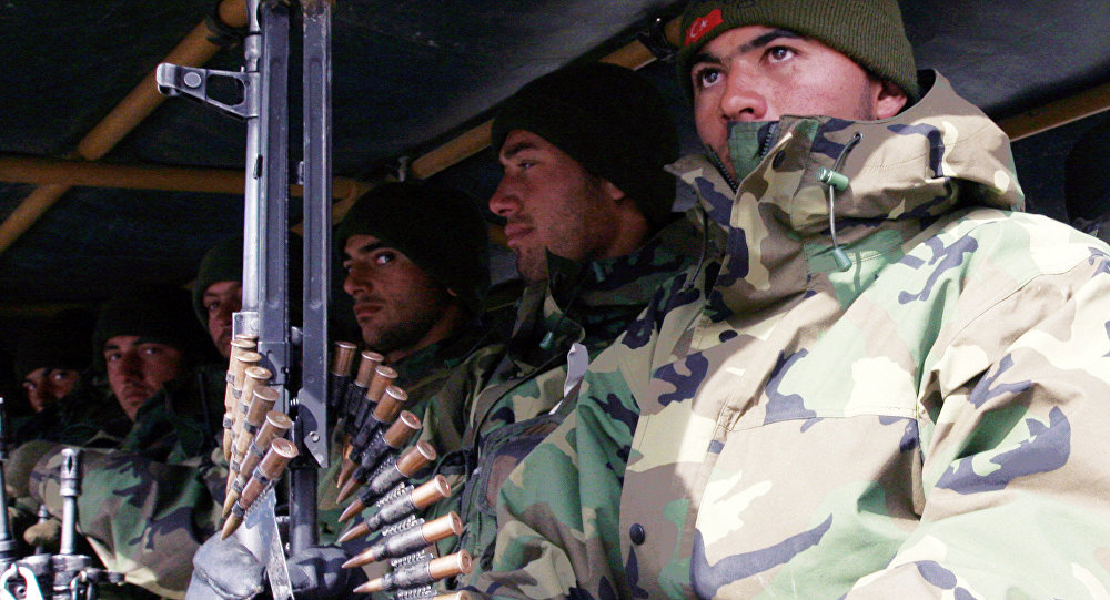 Turkish army troops sit in the back of a military truck as they return from northern Iraq, in Cukurca in Hakkari province at the Turkey-Iraq border, Friday, Feb. 29, 2008.