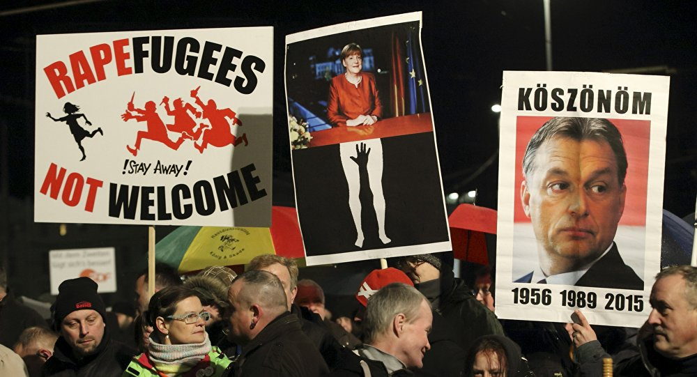 Members of LEGIDA, the Leipzig arm of the anti-Islam movement Patriotic Europeans Against the Islamisation of the West (PEGIDA), take part in a rally in Leipzig, Germany January 11, 2016.