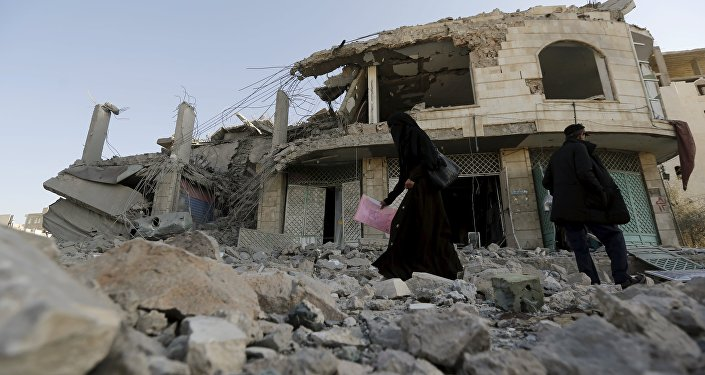 A woman walks past the house of court judge Yahya Rubaid after a Saudi-led air strike destroyed it, killing him, his wife and five other family members, in Yemen's capital Sanaa January 25, 2016