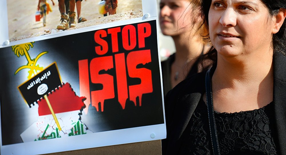 A holds a sign calling to Stop ISIS (ISIS fir Islamic State) on August 13, 2014 as she takes part in a demonstration called by Kurds in support of the Yezidis and the Christians in Iraq, in Arnhem, The Netherlands.