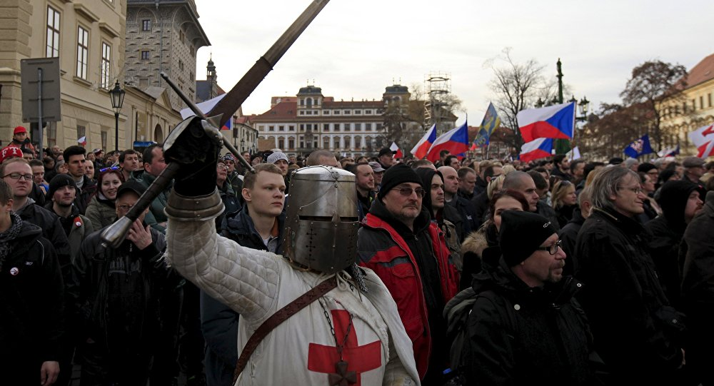 A man dressed as a medieval knight holds a sword during an anti-migrant rally in front of the Prague Castle in Prague, Czech Republic, February 6, 2016