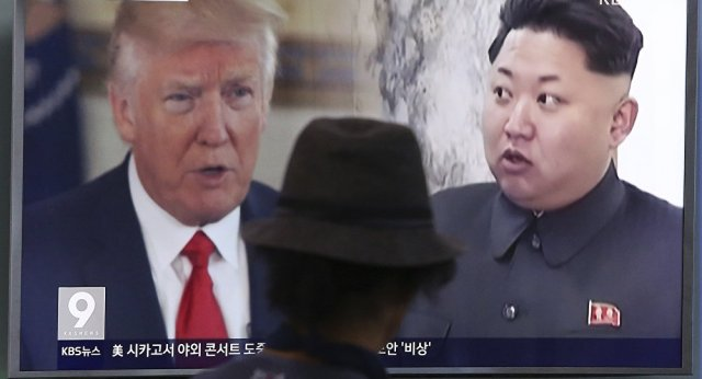 A man watches a television screen showing U.S. President Donald Trump, left, and North Korean leader Kim Jong Un during a news program at the Seoul Train Station in Seoul, South Korea. (File)