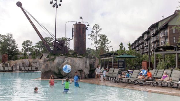 Family playing at the pool at Disney's Wilderness Lodge