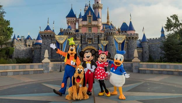 Standing in front of Sleeping Beauty Castle at Disneyland Park, Mickey Mouse, Minnie Mouse, Donald, Pluto and Goofy