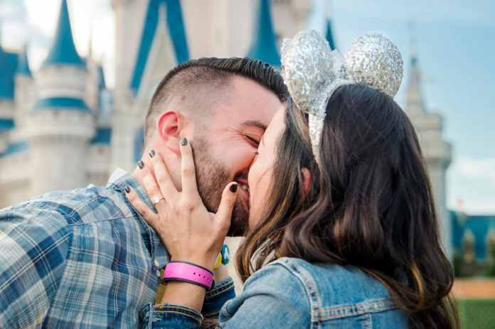 Couple getting engaged at Magic Kingdom Park