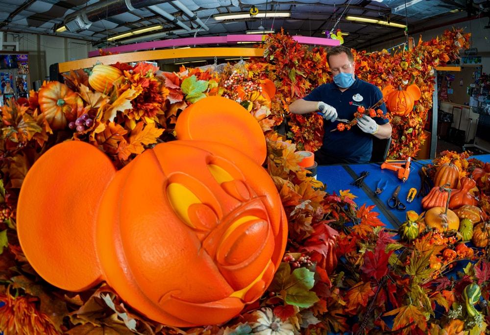 Cast member making fall decor