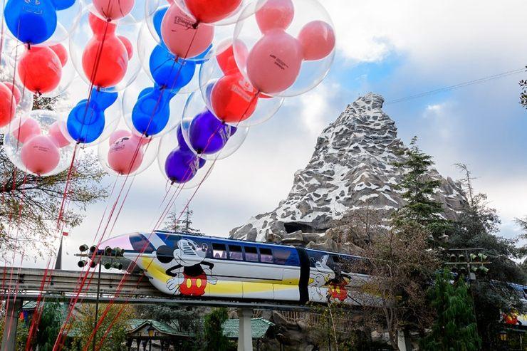 Disneyland monorail passes by Matterhorn Mountain attraction