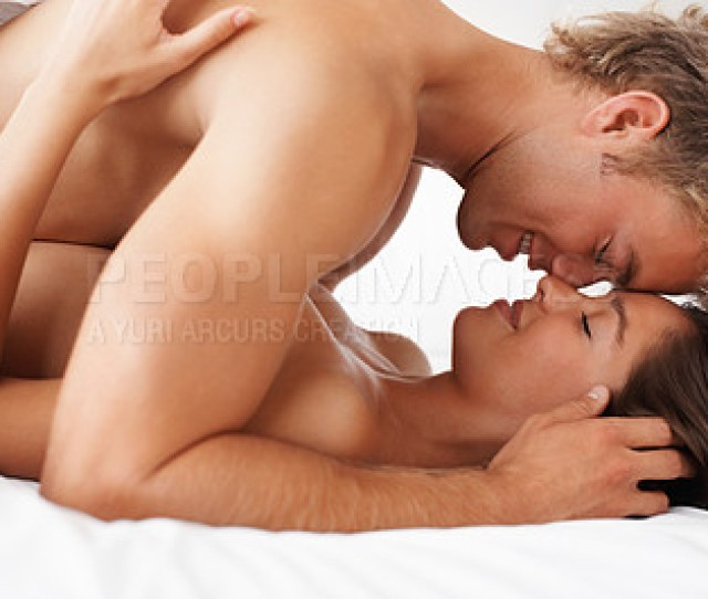 Buy Stock Photo Intimate Couple Enjoying Sexual Intercourse In Bed
