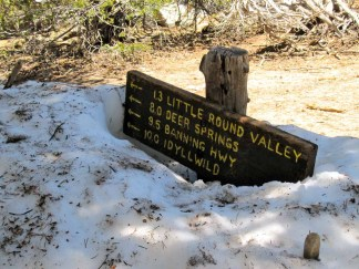 Sign at Saddle Junction buried in snow