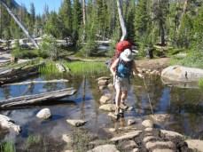Joan stepping across a lock in Sunrise Lakes