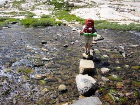 Joan Crossing a Creek
