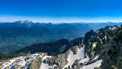 Snow on the side of Pilchuck and mountains for miles