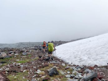 Skirting a snowfield in August