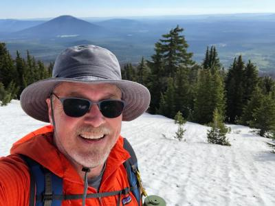 Jeff-traversing-a-snow-field-on-Black-Crater