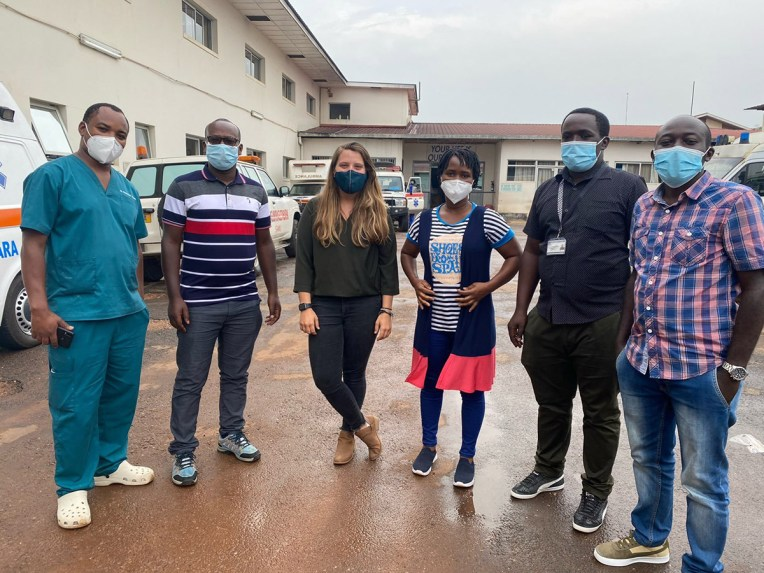 Six student members of the ASSIST team pose for the camera with masks on