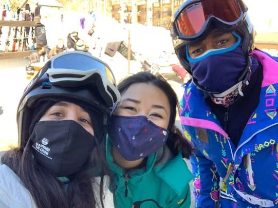 Three students skiing