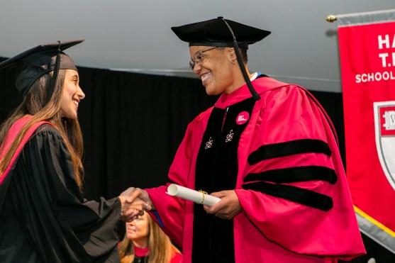 Dean Michelle Williams presenting diploma