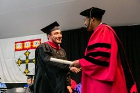 Dean Michelle Williams giving diploma