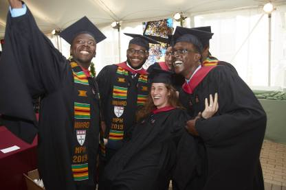 Students in convocation tent