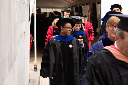 Faculty walking to tent