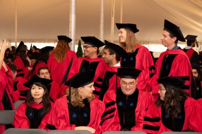 Students in convovation tent