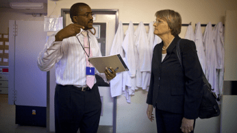 3:35 p.m. Laboratory manager Sikhulile Moyo gives Faust a quick tour of the Lab. Dedicated exclusively to HIV research and treatment, the Lab is designed to handle the high-volume testing necessary for large-scale HIV interventions.