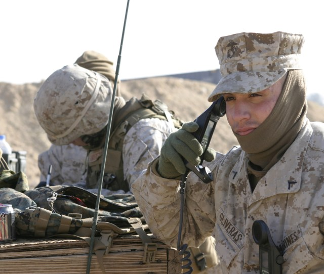 Scott W Oliveras A Field Radio Operator From Headquarters Company Regimental Combat Team 2 Listens For An All Clear On The Radio So That Other Marines