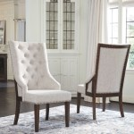 The Hillcott Dark Brown Beige Dining Upholstered Arm Chair Available At Furniture Connection Serving Clarksville Tennessee And Ft Campbell Kentucky