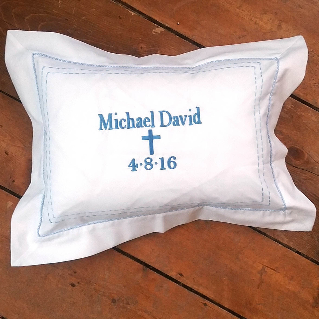personalized baptism pillow with stitching and piping