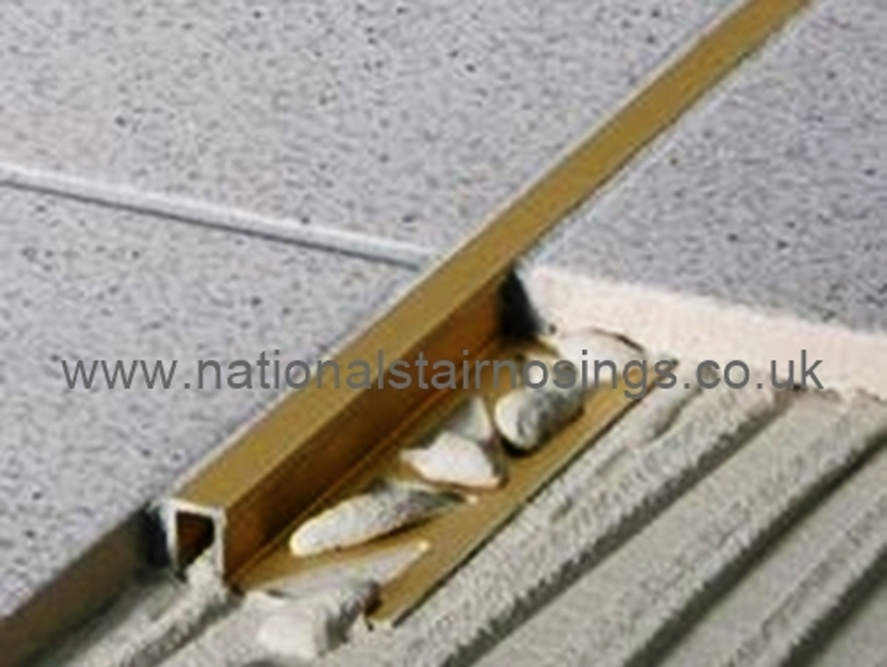https www nationalstairnosings co uk brass rectangular box edge tile trim 2 5m