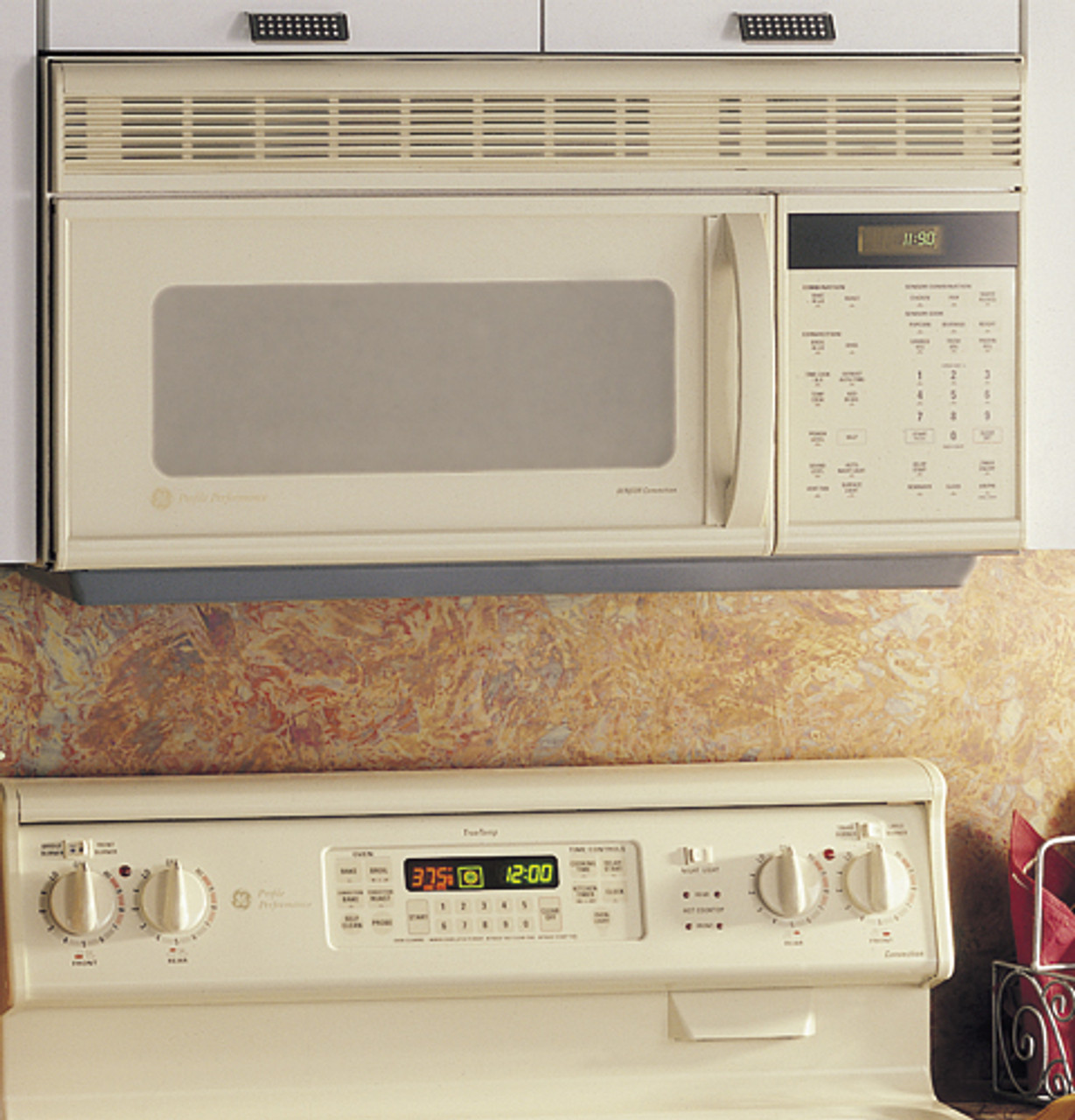 ge profile spacemaker oven with convection microwave cooking and outside venting jvm1190ay