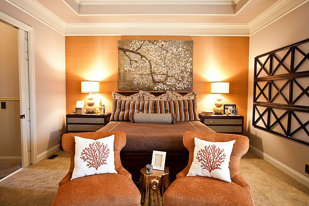 A soft tangerine wall is warms up this master bedroom.