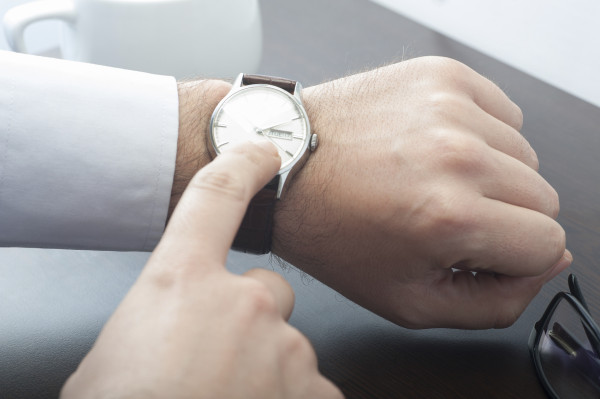 Businessman checking his watch at the meeting