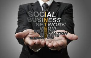 business man hand shows 3d word internet concept