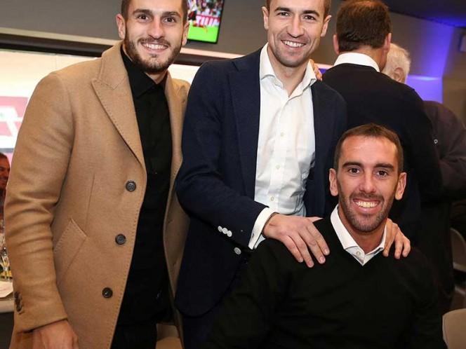 Koke, Gabi y Godín disfrutaron del evento. Los tres son referentes del cuadro de Simeone (EFE)