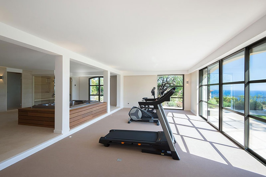 Taking an exercise break in this house is like escaping on a mini-vacation; the workout room with views over the hills of Provence also has a hot tub and sauna.