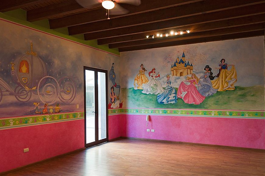 The children's rooms of this Mexican estate are painted with colorful Disney-themed murals, and the children's bathroom has a child-friendly, half-height sink.