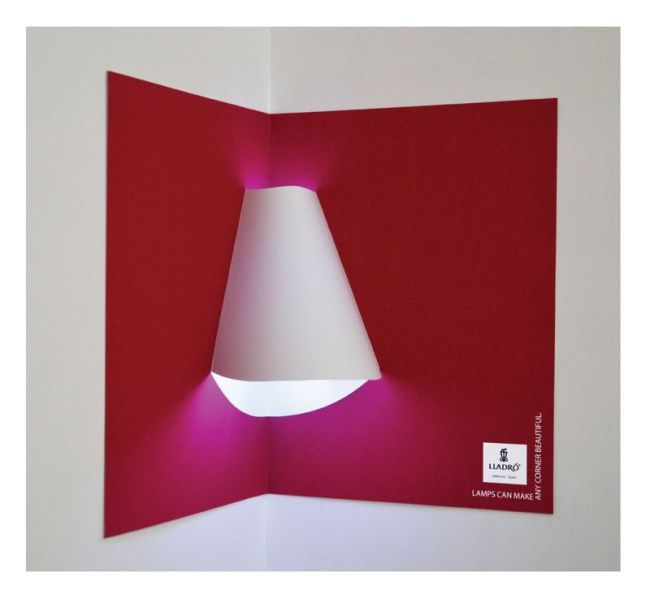 Interactive print advertisement by Lladro Lighting with lamp shade included in pop-up book