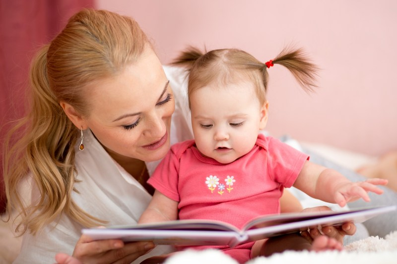 bigstock-happy-mother-reads-a-book-to-b-83953991