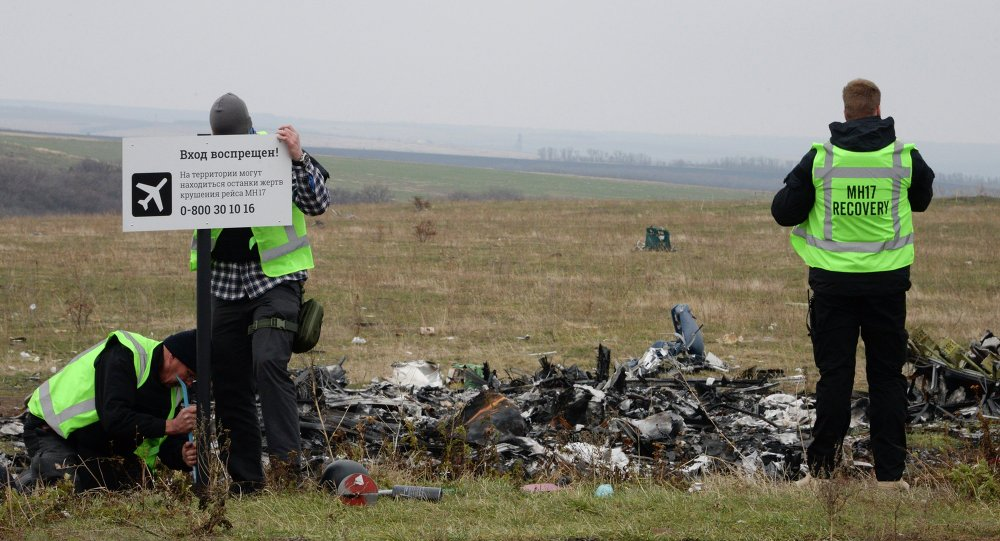 MH17 flight recovery team members erect a  No Trespassing sign in an area of the Malaysia Airlines Flight 17 plane crash in the village of Hrabove, Donetsk region, eastern Ukraine
