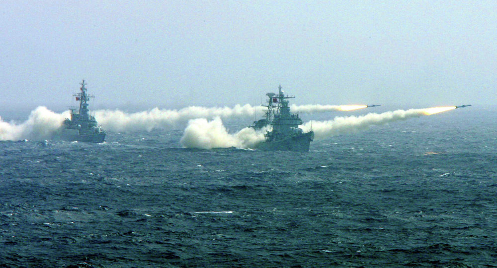 Two warships of the South China Sea Fleet of the Chinese Navy fire missiles during a competitive training.