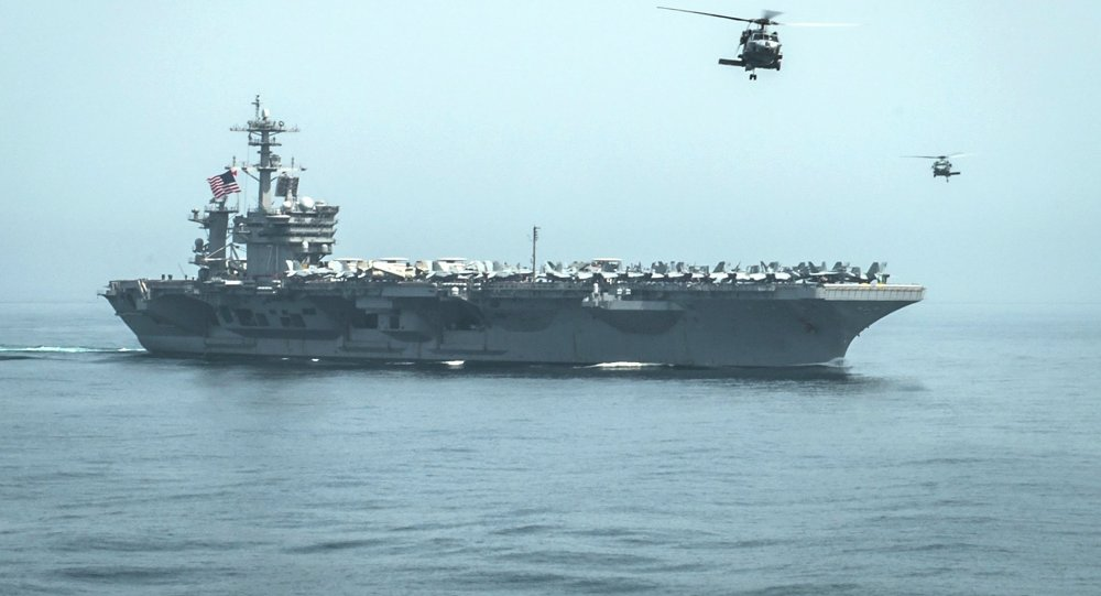 Helicopters fly from the aircraft carrier USS Theodore Roosevelt