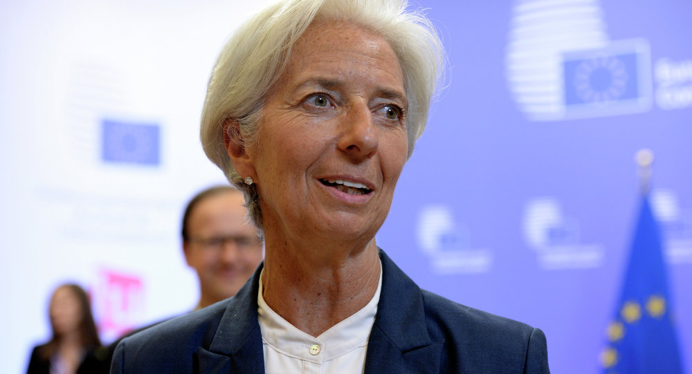 International Monetary Fund's (IMF) Managing Director Christine Lagarde talks to the media at the end of an Eurozone Summit over the Greek debt crisis in Brussels on July 13, 2015
