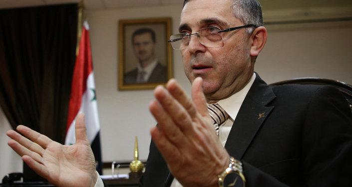 Syrian Minister of State for National Reconciliation Affairs Ali Haidar gives an interview with AFP in Damascus on November 10, 2014.