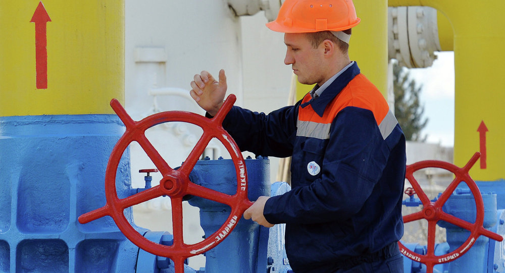 An employee turns a valve of a gas installation during a training exercise for handling emergencies at a gas-pumping station on the gas pipeline in the small town Boyarka on April 22, 2015 in the Kiev region