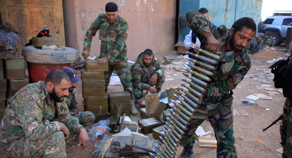 Syrian pro-government forces prepare their weapons at a train station in the area of Arkile near the airport of Kweyris, in the northern Syrian province of Aleppo, on November 20, 2015