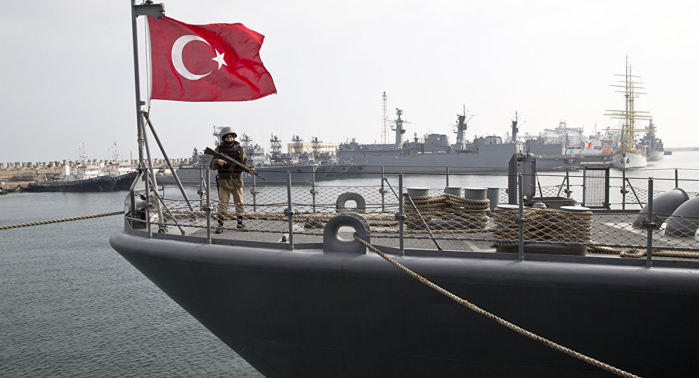 A Turkish marine serviceman stands on the deck of a Turkish navy TCG Turgutreis vessel in the Black Sea port.