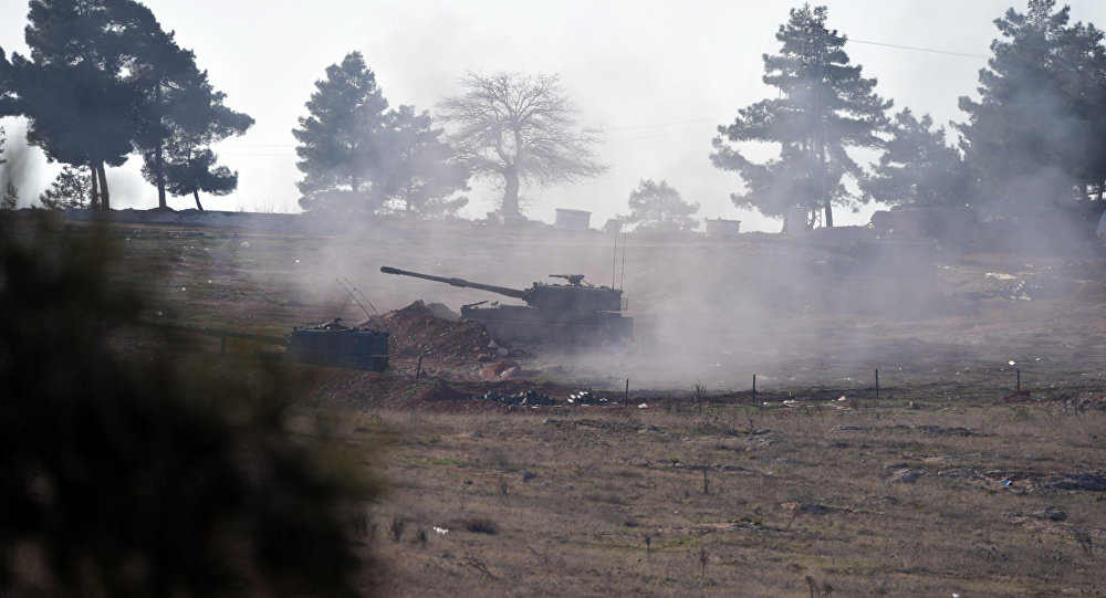 Turkish artillery fire from the border near Kilis toward northern Syria, in Kilis, Turkey, Monday, Feb. 15, 2016.
