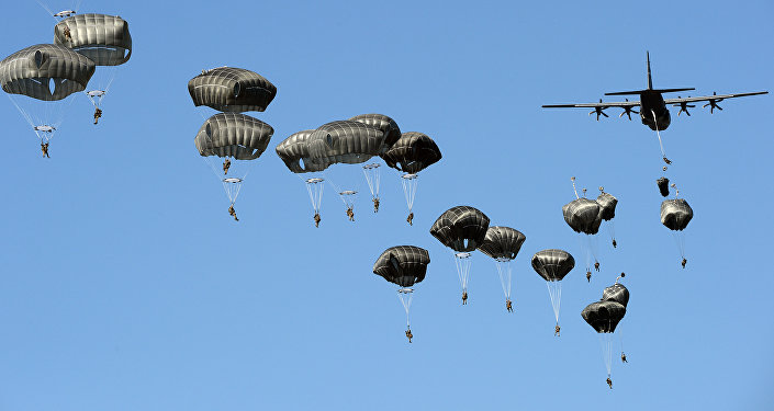 US troops land with parachutes at the military compound near Torun, central Poland, on June 7, 2016, as part of the NATO Anaconda-16 military exercise.